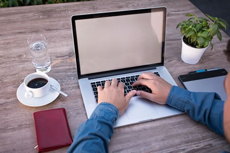 Laval web designer working on a website